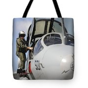An Airman Makes A Final Look Over An Tote Bag