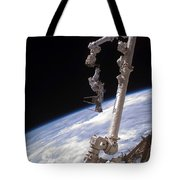 An Astronaut Anchored Tote Bag