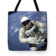 An Astronaut Floats And Maneuvers Tote Bag