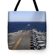An Av-8b Takes Off From The Flight Deck Tote Bag