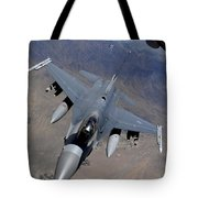 An F-16 Fighting Falcon Returns Tote Bag