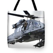 An Hh-60g Pavehawk Helicopter In Flight Tote Bag