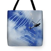 An Hh-60h Sea Hawk Helicopter Releases Tote Bag