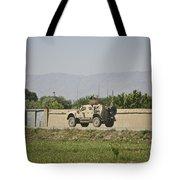 An M-atv Driving Towards Aliabad Tote Bag