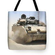 An M2 Bradley Fighting Vehicle Patrols Tote Bag