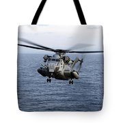 An Mh-53e Sea Dragon In Flight Tote Bag