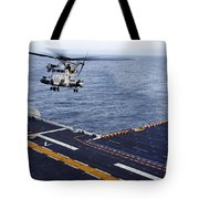 An Mh-53e Sea Dragon Prepares To Land Tote Bag