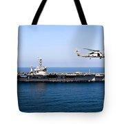 An Mh-60r Sea Hawk Flies Tote Bag