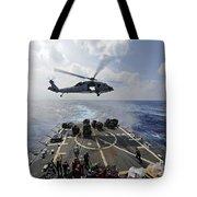 An Mh-60r Sea Hawk Transfers Supplies Tote Bag
