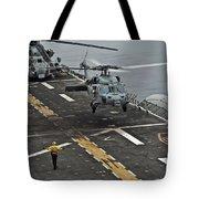 An Mh-60s Sea Hawk Lands Aboard Tote Bag