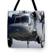 An Mh-60s Seahawk Delivers A Pallet Tote Bag
