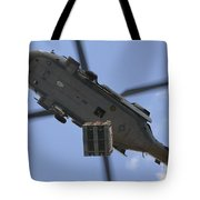 An Mh-60s Seahawk Helicopter Airlifts Tote Bag