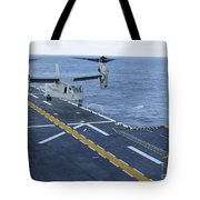 An Mv-22 Osprey Lands Aboard Tote Bag
