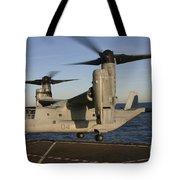 An Mv-22 Osprey Lands Aboard Usns Tote Bag