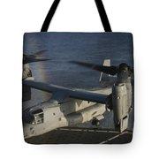 An Mv-22 Osprey Prepares To Land Aboard Tote Bag