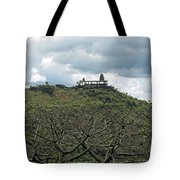 An Old Temple Building On Top Of A Hill With A Lot Of Clouds In The Sky Tote Bag