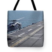 An Sh-60 Sea Hawk Helicopter Lands Tote Bag