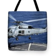 An Sh-60b Seahawk Helicopter Performs Tote Bag