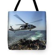 An Sh-60r Sea Hawk Delivers Pallets Tote Bag