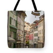 Antique Shop Sign On A Shopping Street Tote Bag