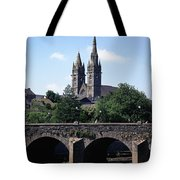 Arch Bridge Across A River With A Tote Bag
