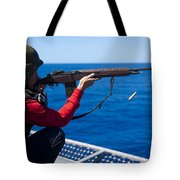 Aviation Ordnanceman Fires An M-14 Tote Bag