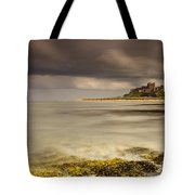 Bamburgh Castle Under A Cloudy Sky Tote Bag by John Short