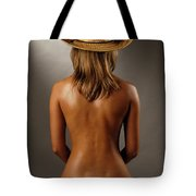 Bare Back Of A Suntanned Woman In A Straw Hat Tote Bag