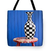 Blach And White Vase On Stool Against Blue Wall Tote Bag