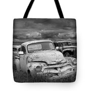 Black And White Photograph Of A Junk Yard With Vintage Auto Bodies Tote Bag