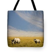 Black Rhinos Walking Across The Crater Tote Bag