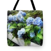 Blue Hydrangea On White Fence Tote Bag