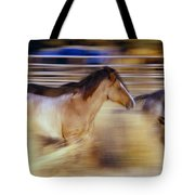 Blurred View Of Horses Running Through Tote Bag