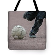 Boy Playing Soccer With A Ball Tote Bag