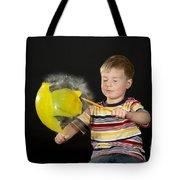 Boy Popping A Balloon Tote Bag