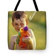 Boy Spraying Water Gun Tote Bag