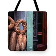 Bread Is Displayed In A Store Window Tote Bag