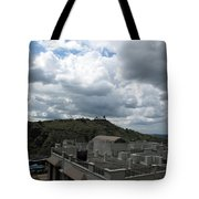 Buildings Cover The Lower Section Of A Hill That Has A Temple At The Top With Clouds Covering The Sk Tote Bag