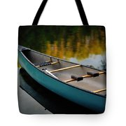 Canoe And Reflections On A Still Lake Tote Bag