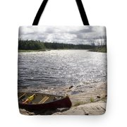 Canoe Pulled Up On The Shore Tote Bag
