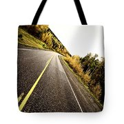 Center Lines Along A Paved Road In Autumn Tote Bag