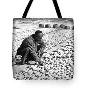 Chinese Man Drying Fish On The Shore - C 1902 Tote Bag