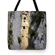 Climber Near Prehistoric Cliff Dwelling Tote Bag