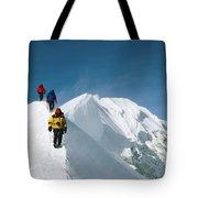 Climbers Hike Along A Ridge Tote Bag