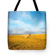 Combine Harvesting A Wheat Field Tote Bag