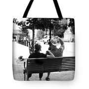 Couple Resting On A Downtown Bench On A Windy Day Tote Bag