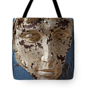 Cracked Face On Blue Wall Tote Bag