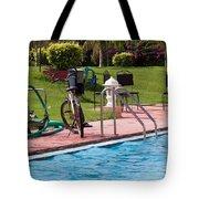 Cycle Near A Swimming Pool And Greenery Tote Bag