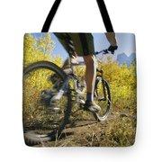 Cyclist Rides Mountain Bike Among Trees Tote Bag