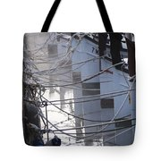 december's cold morning - A foggy day in port mahon with a line of traditional llaut boats  Tote Bag